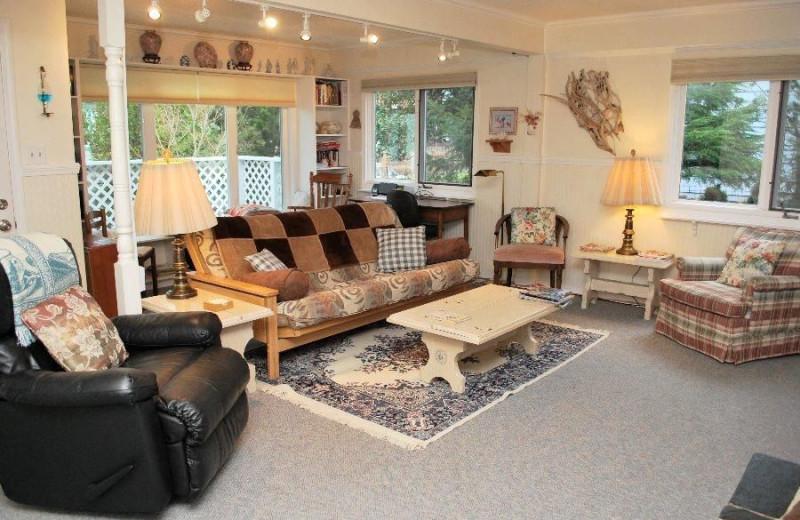 Rental living room at Beachhouse Vacation Rentals.