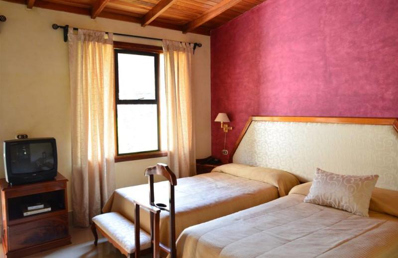 Guest room at Martino Resort & Spa.