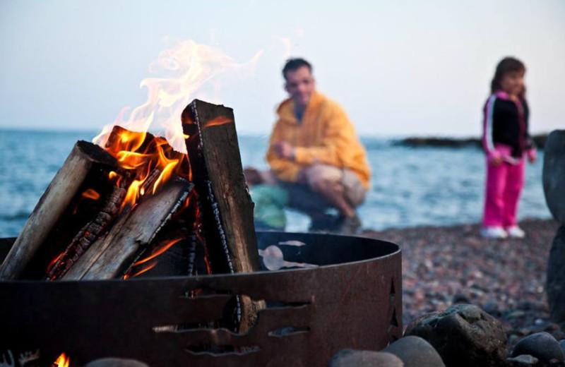 Bonfire on beach at Bluefin Bay on Lake Superior.