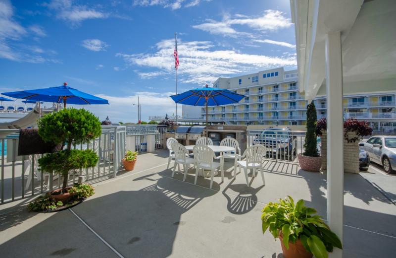 Outdoor patio at Fleur De Lis Beach Resort.