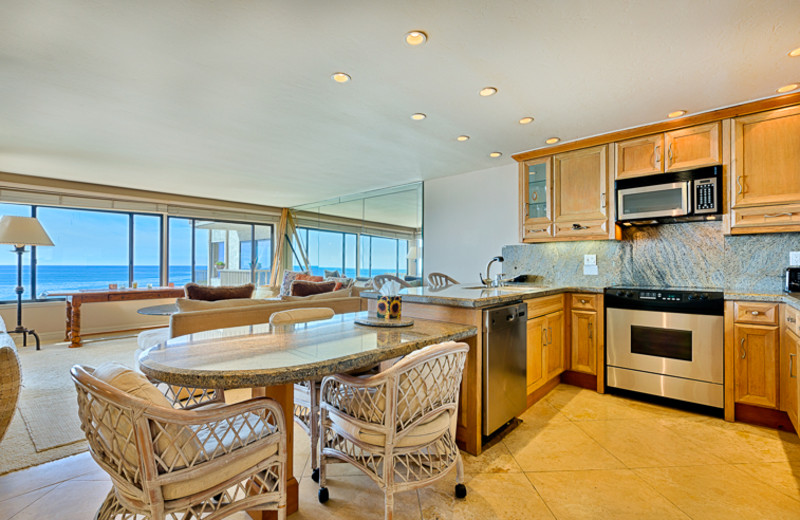 Vacation rental kitchen and dining room at Seabreeze Vacation Rentals, LLC.