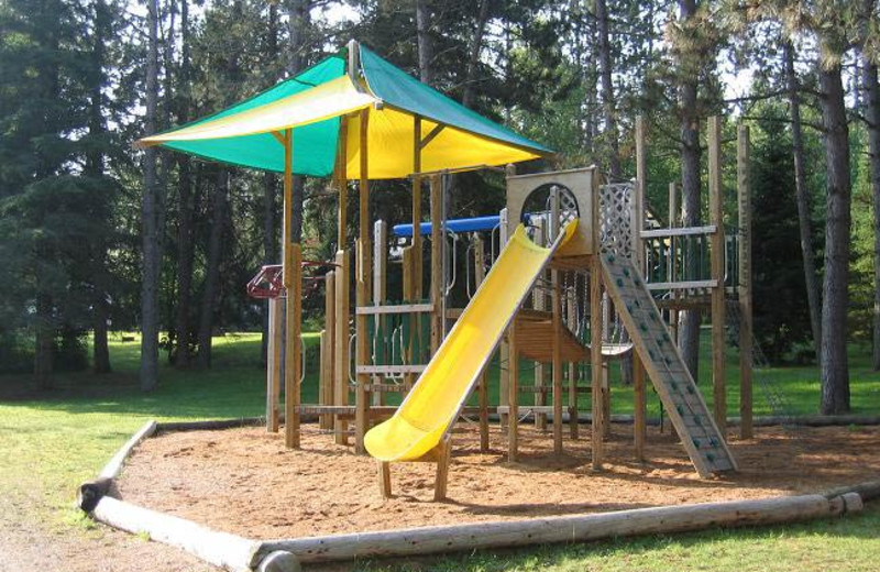Kid's playground at Cabin O'Pines Resort & Campground.