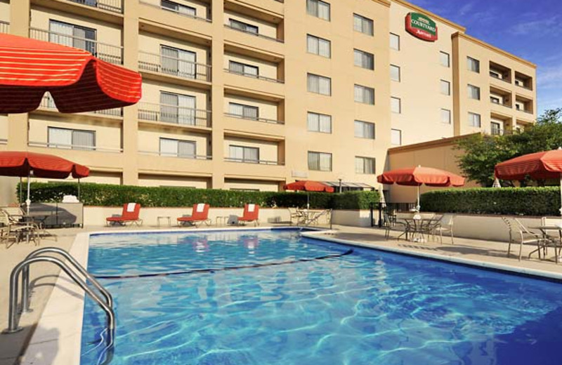 Outdoor pool at Courtyard by Marriott Dallas Central Expressway.