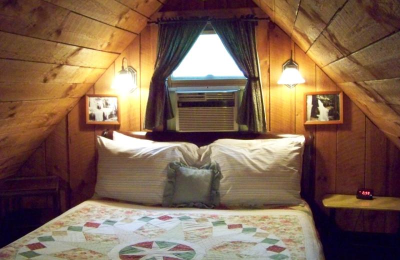 Cabin bedroom at Hocking Hills Cabins.