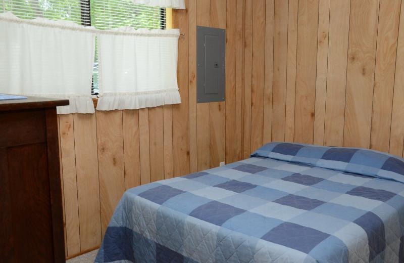 Cabin bedroom at Riverside Resort.