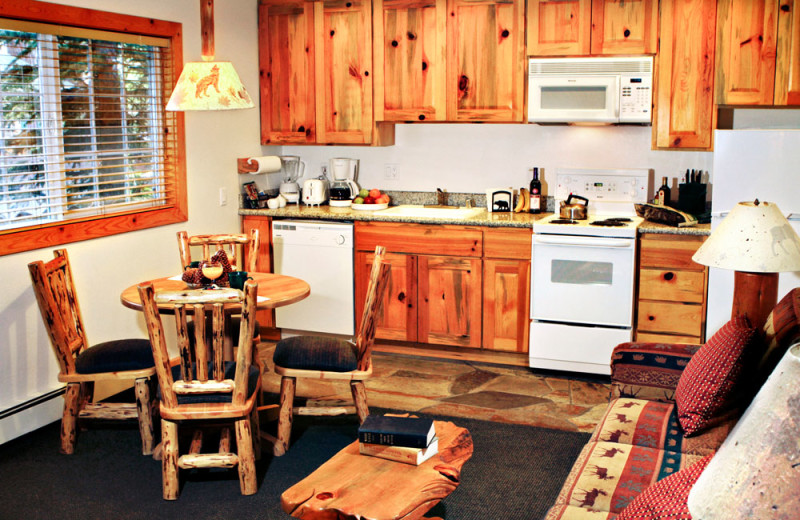 Dining Area and Kitchen of a One Bedroom Unit at the Red Wolf Lakeside Lodge