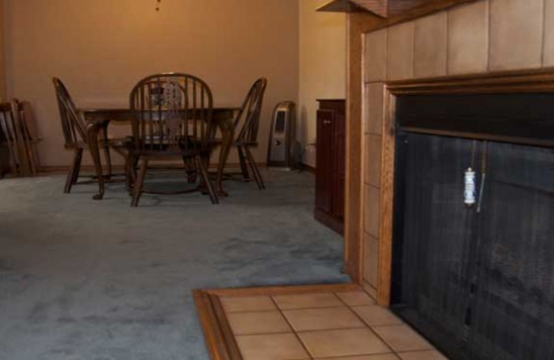 Guest fireplace and dining room at Copper Chase Condominiums.