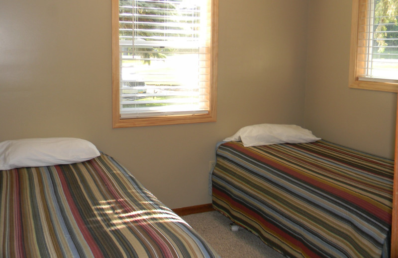 Cabin bedroom at Otter Tail Beach Resort.