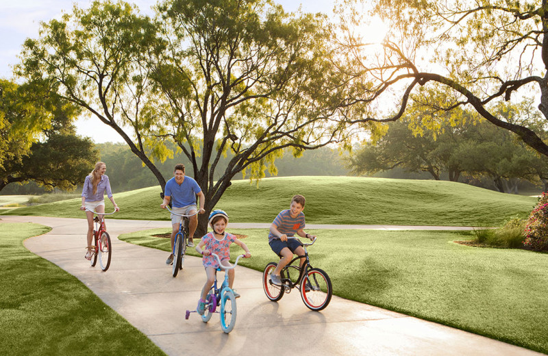 Family biking at Hyatt Regency Hill Country Resort and Spa.