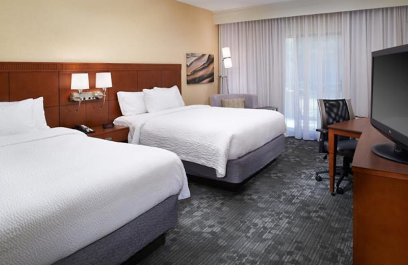 Guest room at Courtyard by Marriott Detroit Livonia.