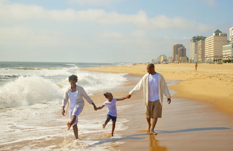 Family on beach at Dolphin Run Condominium Association. Inc.
