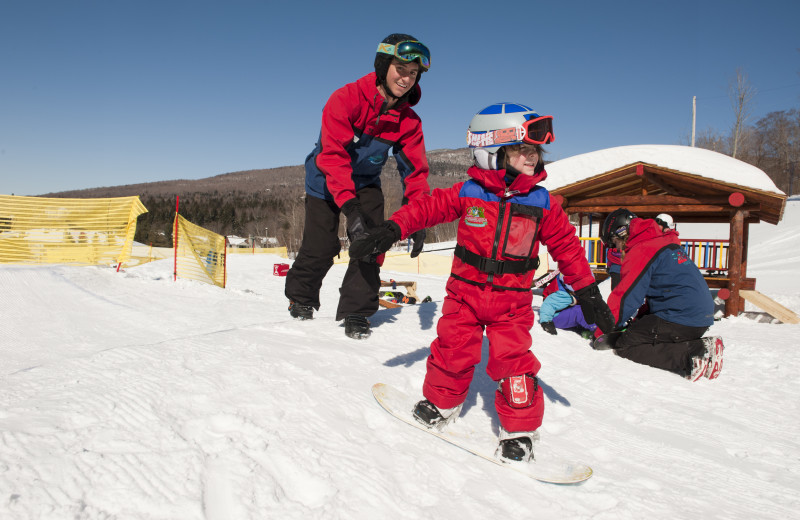 Snowboard at Smugglers' Notch Resort.
