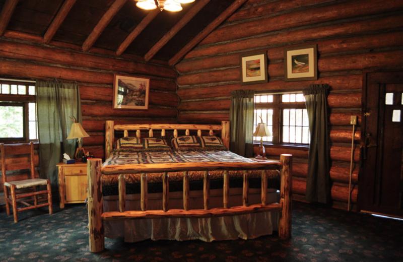 Cabin bedroom at Crossed Sabres Ranch.