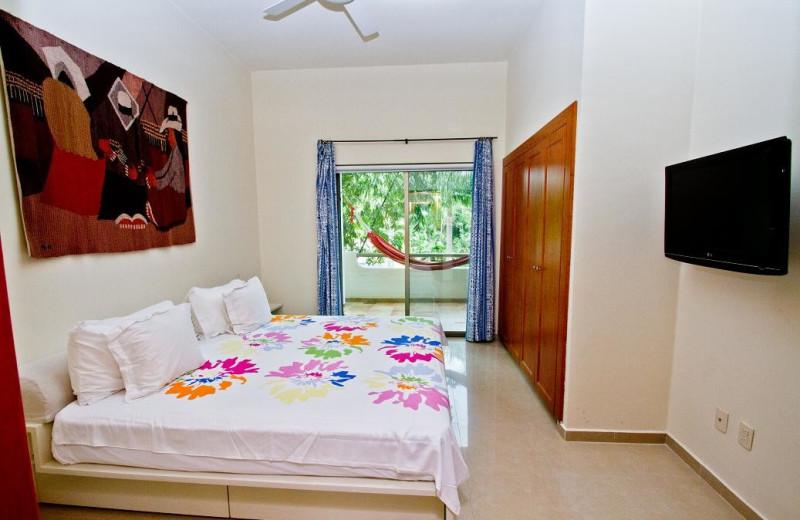 Guest room at Riviera Maya Suites.