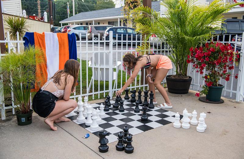Family playing giant chess at Footbridge Beach Motel.