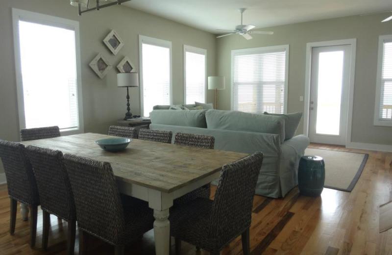 Vacation rental dining and living room at Teresa's Beach Vacation Rental Homes.