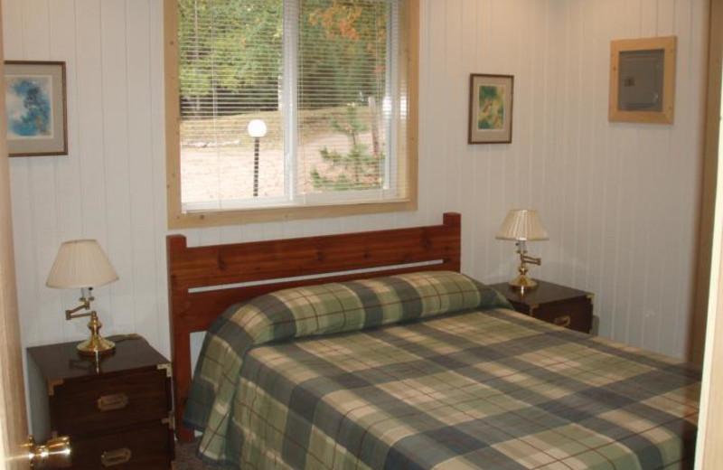Cabin bedroom at White Birch Village Resort.