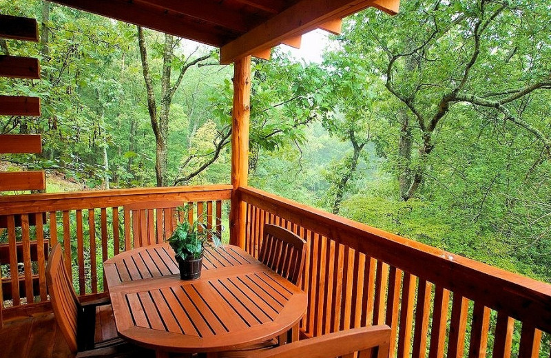 Cabin balcony at Lake Forest Luxury Log Cabins.