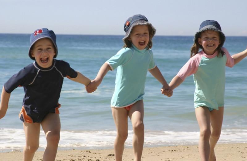 Children on the beach at Tamarack Lodge.