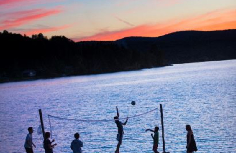 Volley ball on the sandy beach at Jackson's Lodge, on the shores of pristine international Wallace Pond in Canaan, Vermont.