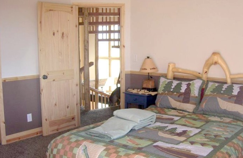 Queen size bedroom at Fall River Lodge.