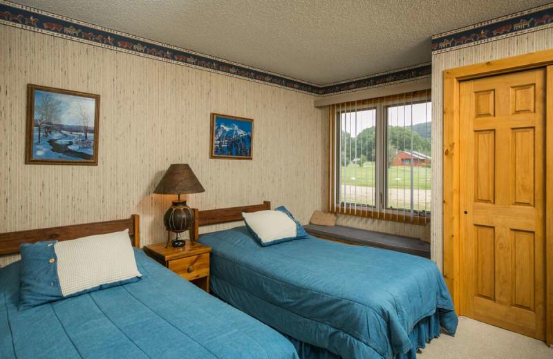 Cabin bedroom at The Glen Eden Resort.