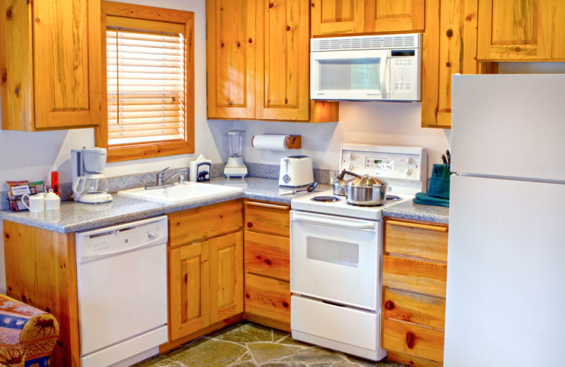 Kitchen of a Two Bedroom Unit at the Red Wolf Lakeside Lodge