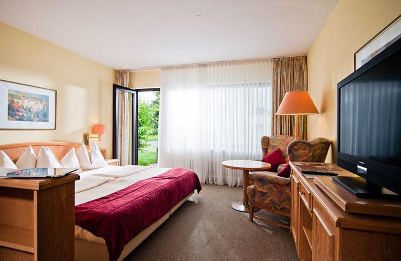 Guest room at Sporthotel & Resort Grafenwald.