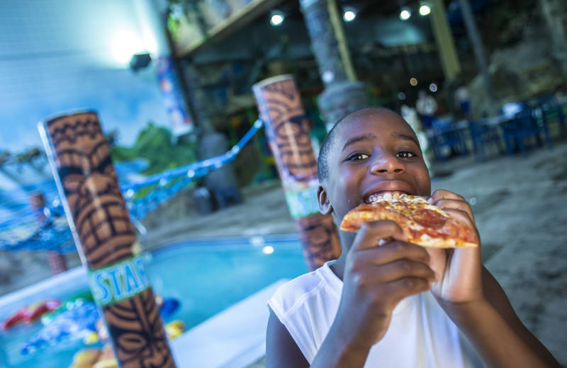 Eating pizza at Edgewater Hotel & Waterpark.