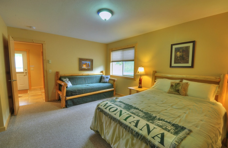 This is one of the bedrooms in our 3 bedroom deluxe cabin. The 3 bedroom cabin can sleep a total of 10 people comfortably. Best of all it's located only 1/2 mile from Glacier National Park
