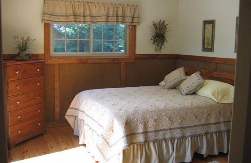 Cottage bedroom at Riverbend Retreat Resort Lodge & Cottages.