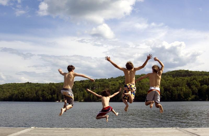 Jumping in lake at Deerstalker Resort.