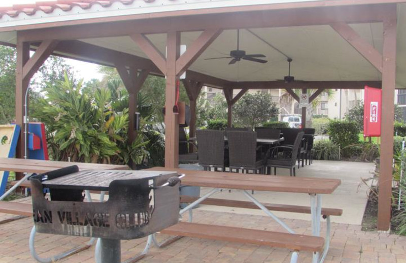 Picnic Area with Charcoal Grills at Beach Vacation Rentals.