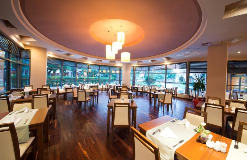 Dining at Merit Limra Hotel & Resort.