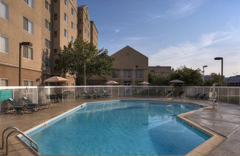 Outdoor pool at Homewood Suites by Hilton Dallas Market Center.