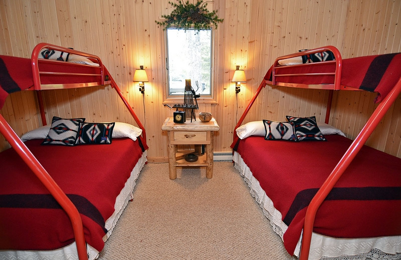 Cabin bedroom at North Country Vacation Rentals.