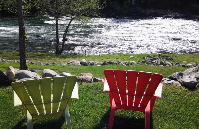 Chairs by river at Strawhouse Resorts.