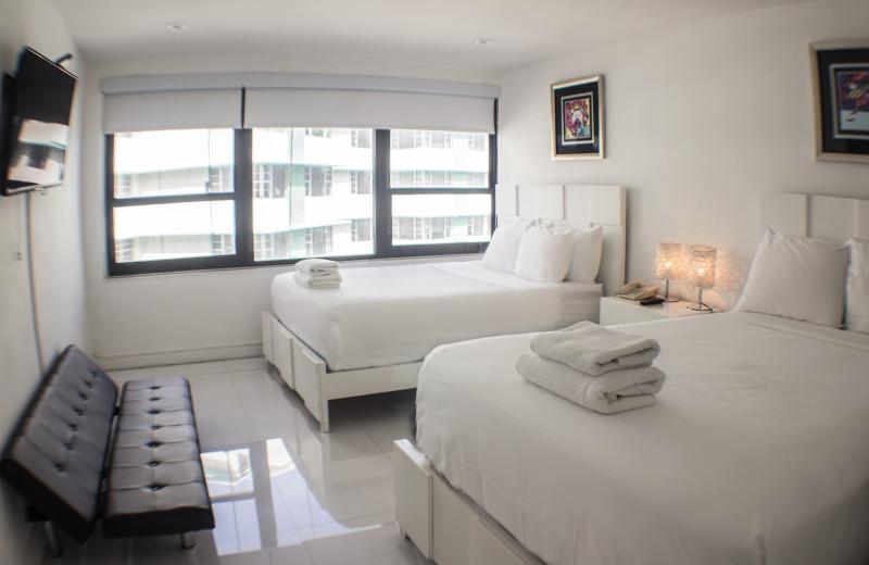 Guest bedroom at The Alexander All Suite Oceanfront Resort.