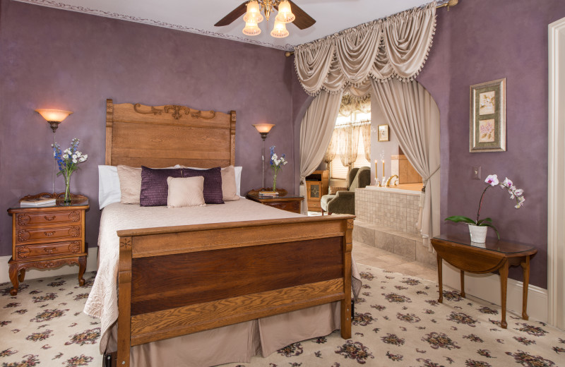 Offers a romantic Victorian two-room suite featuring a two-person lounger whirlpool tub and corner fireplace. An antique six ft. oak headboard adorns the queen-size bed, and the room is appointed with a unique oak armoire/dresser, and TV. The sunroom/sitting room has a sofa bed and ottoman, recliner & TV. The room's 1880's bathroom has been restored, featuring built-in soaking tub/shower, corner sink, and unique split window/medicine cabinet. This guest room can accommodate a third person 12 yrs. or older for an additional cost of $35/day.
