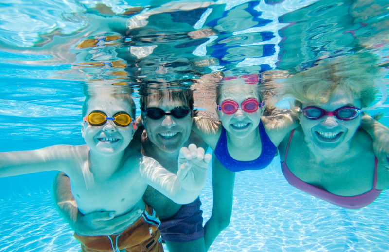 Family swimming at Split Rock Resort & Golf Club.