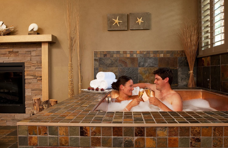 Couple in hot tub at Tigh-Na-Mara Resort.