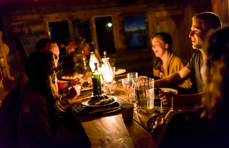 Family dining at Algonquin Log Cabin.