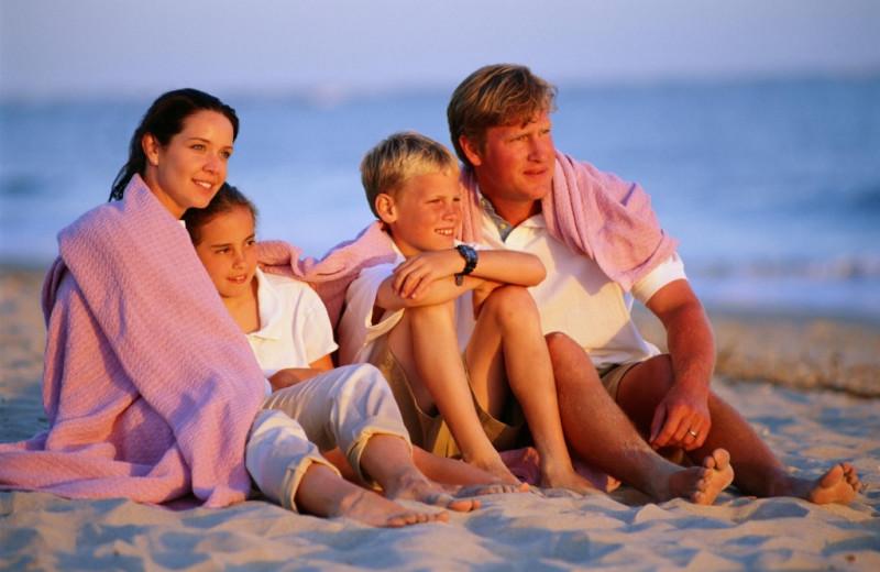 Family on beach at Destin West Beach & Bay Resort.