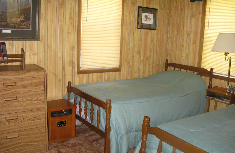 Cabin bedroom at Harris Hill Resort.