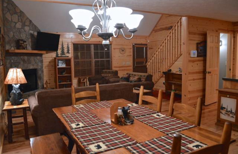 Cabin dining table at Mountain Getaway Cabin Rentals.