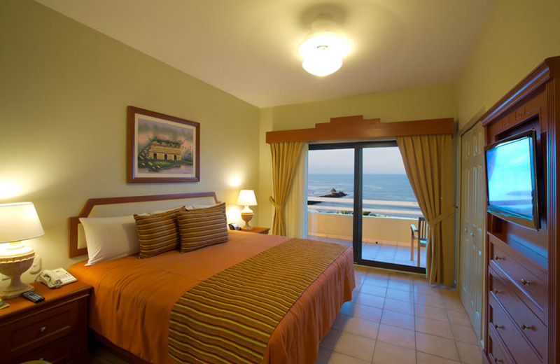 Guest room at Paradise Village Beach Resort & Spa.