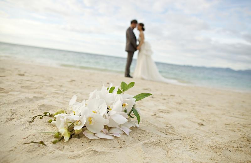 Beach wedding at Aqua Blue Hotel.