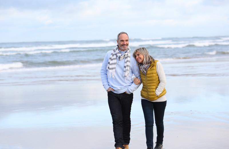 Couple on beach at Sunset Properties.