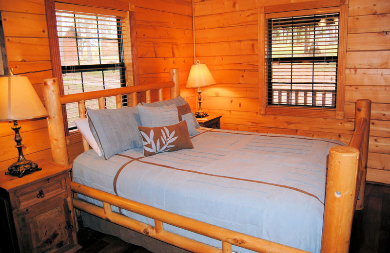 Cabin bedroom at Cabin Fever Resort.