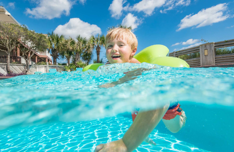 Kid in pool at The Winds Resort Beach Club.